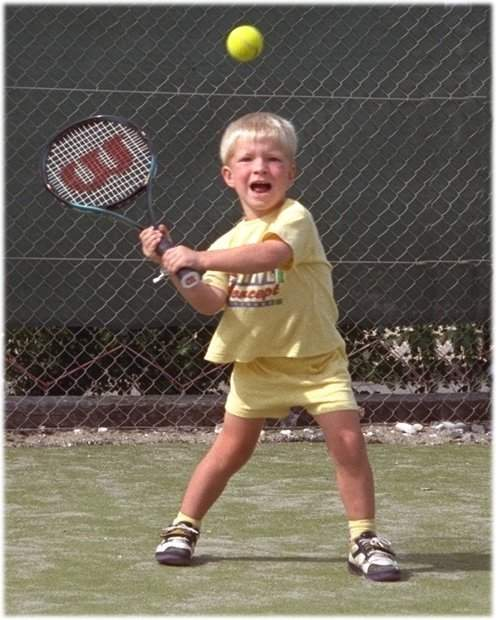 4 - Nicolai shows a double forehand /Aug. 1995