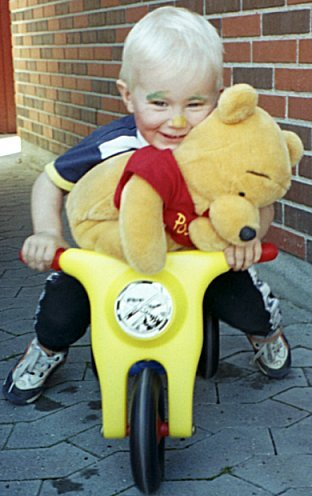 Winnie the Pooh goes for a ride with Daniel /Sept. 1999